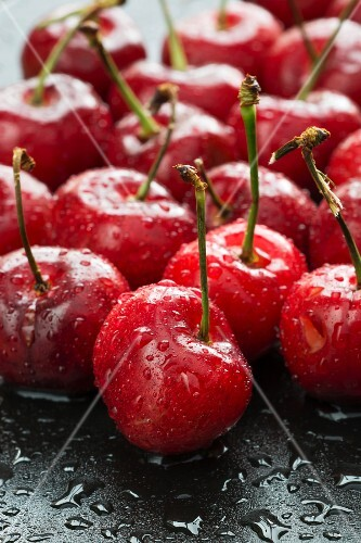 Fresh cherries with drops of water (close-up)
