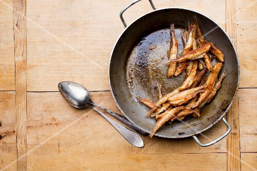Fried smelts in a pan