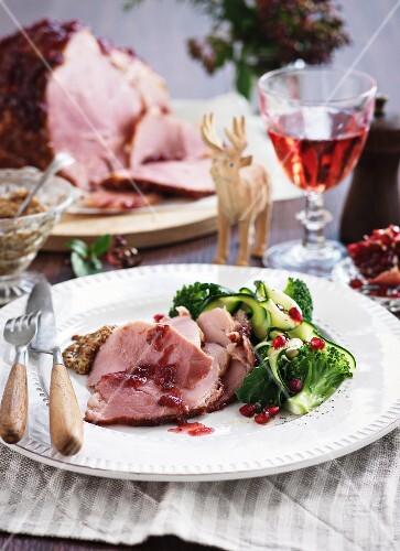 Roast ham with broccoli and pomegranate seeds for Christmas