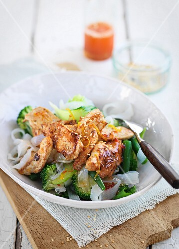 Lemon and chilli chicken on rice noodles, broccoli and beans