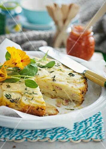 Potato tortilla with nasturtium flowers