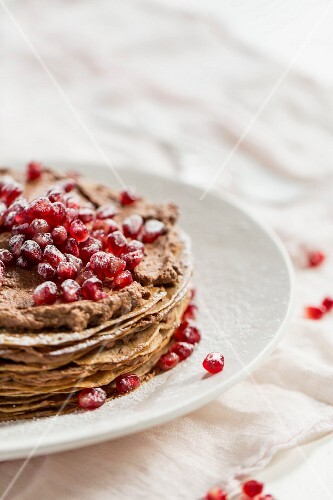 Crepes cake with pomegranate seeds
