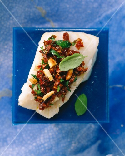 Tomato crust with basil, parsley and pine nuts on fish