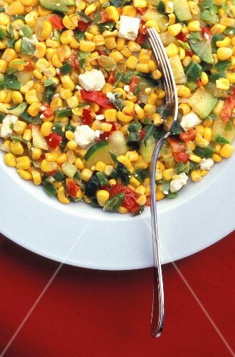 Sweet corn salad with courgettes and feta cheese