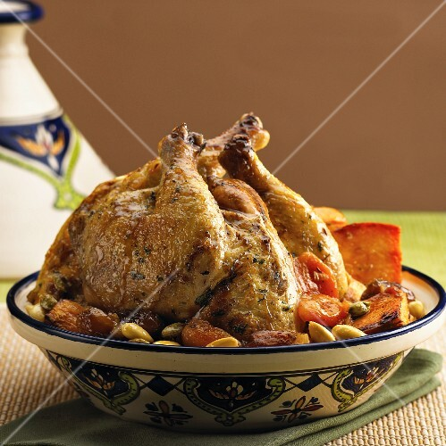 Roast chicken with dates, apricots, almonds and pistachios