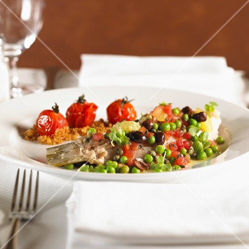 Seabream with peas, olives and cherry tomatoes