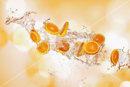 Orange slices with a splash of water