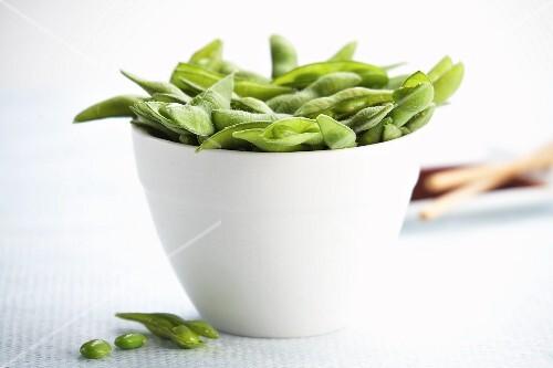Edamame beans in a white bowl