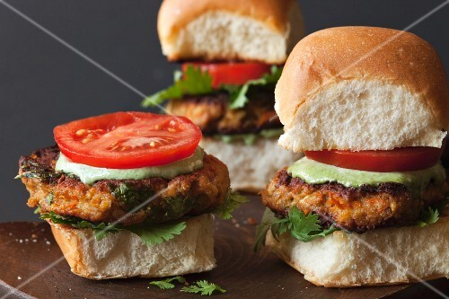 Indian veggie burgers on a wooden board