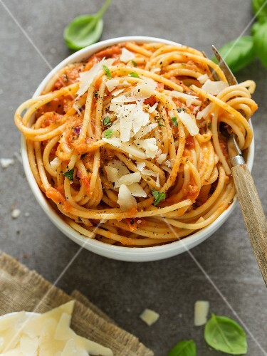 Pasta al pomodoro (pasta with tomato sauce, Italy) with grated Parmesan
