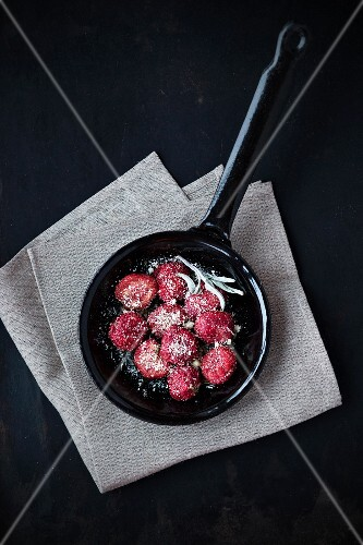 Beetroot gnocchi in a pan