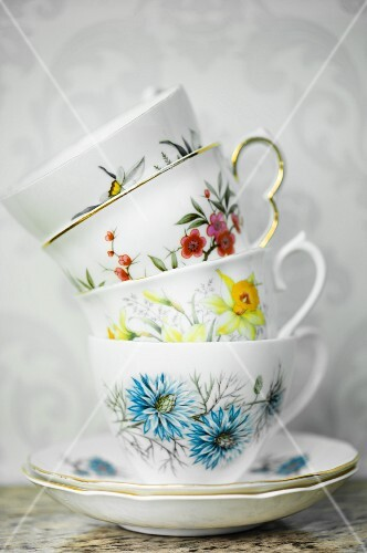 A stack of vintage, floral-patterned cups