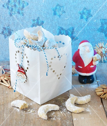 Vanilla crescent biscuit in a decorative paper bag