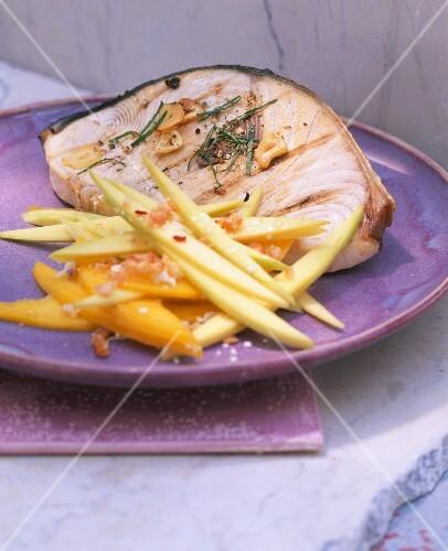 Grilled swordfish steak with a mango salad