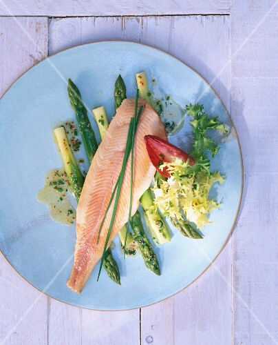 Smoked char on green asparagus