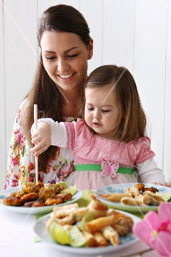 A woman and a little girl eating