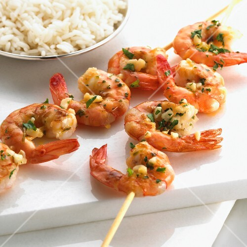 Garlic prawn skewers with rice
