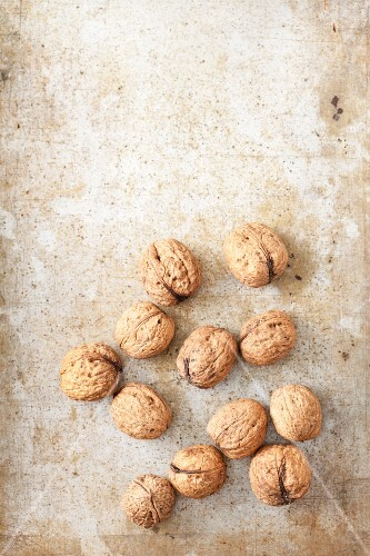 Walnuts on a metal surface