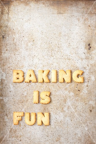 The words 'Baking is fun' made from biscuit letters