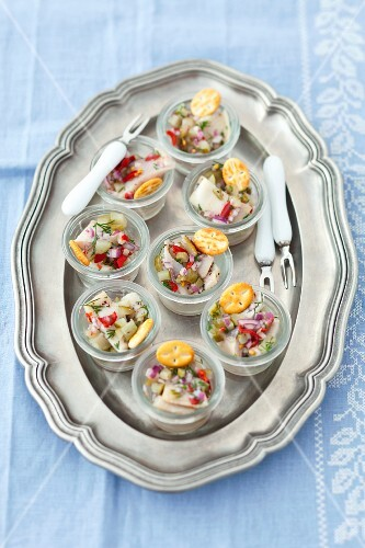 Herring salad with gherkins, chilli, onions and dill served with crackers