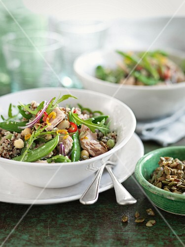 Quinoa salad with mange tout, rocket, fish, chickpeas and chilli