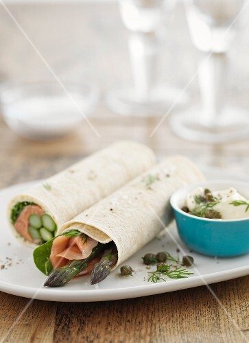 Asparagus and smoked salmon rolls with a dip