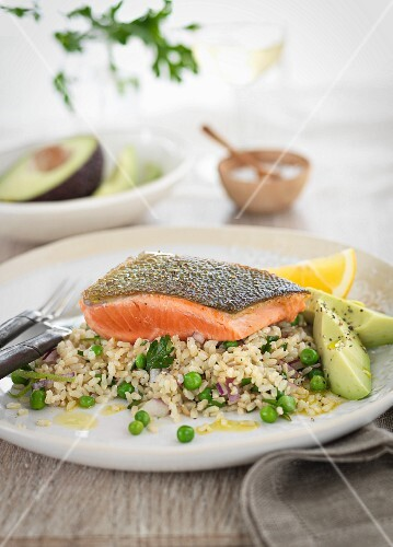 Salmon fillet on vegetable rice with avocado