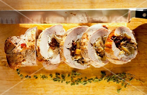Sliced pork loin roulade filled with apples and figs