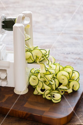 Courgette noodles being made with a spiral cutter