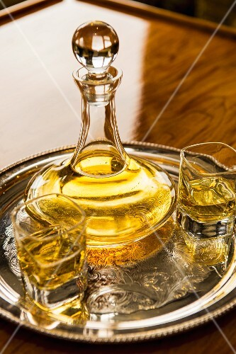 Whiskey in a carafe and glasses on a tray
