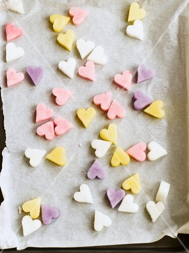 Sugar hearts on a baking tray