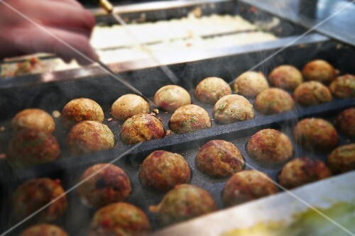 Takoyaki (octopus balls, Japan) in a restaurant kitchen