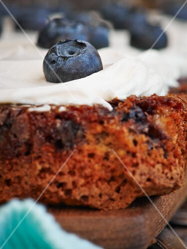 Apple and nut cake with cream cheese and blueberries