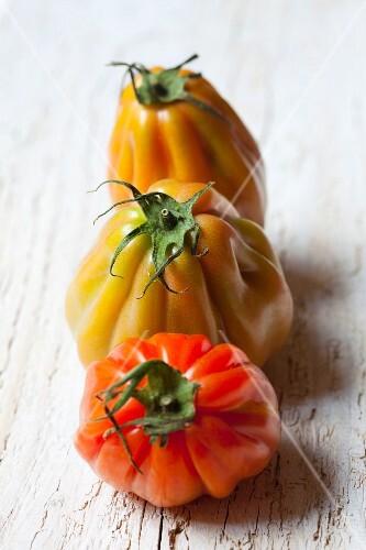Three organic tomatoes from Sicily