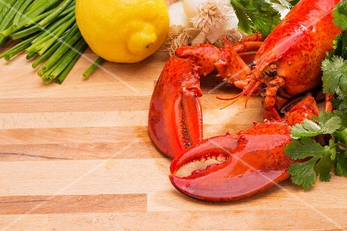 Steamed lobster with lemons and fresh vegetables