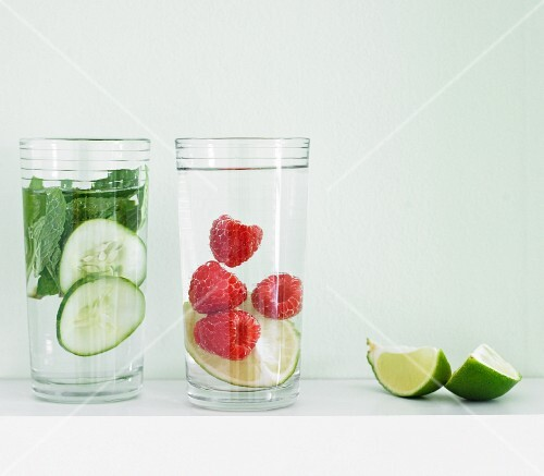 Flavoured water (cucumber-mint, and raspberry-lime) with lime wedges