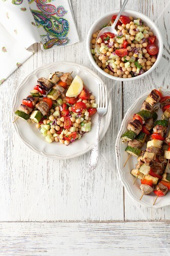 Pork loin and vegetable skewers with a chickpea, cucumber and tomato salad