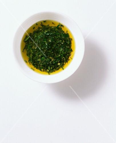 A bowl of Italian herb oil
