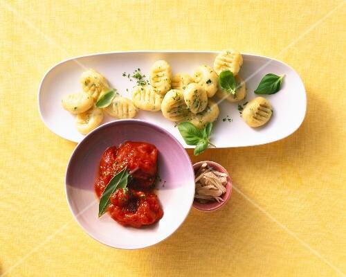 Potato gnocchi with herbs and tomato sauce
