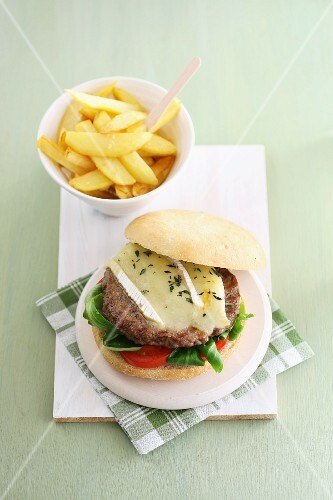 A hamburger with Camembert and chips