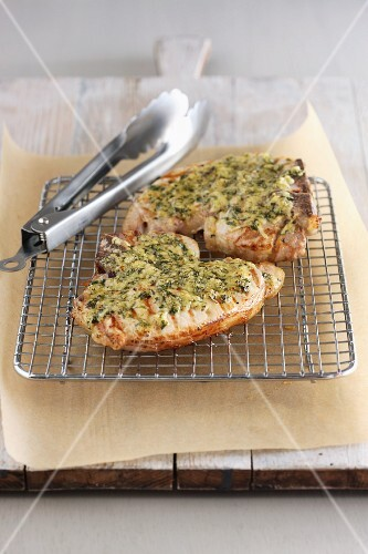 Grilled pork chops with a herb crust