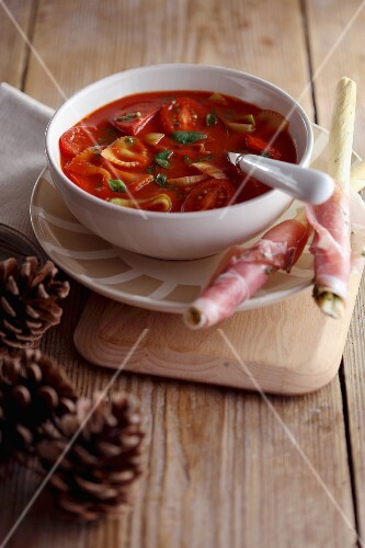 Minestrone with pasta and grissini wrapped in ham