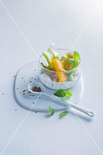 Yoghurt with fruit, flax seeds and lemon balm