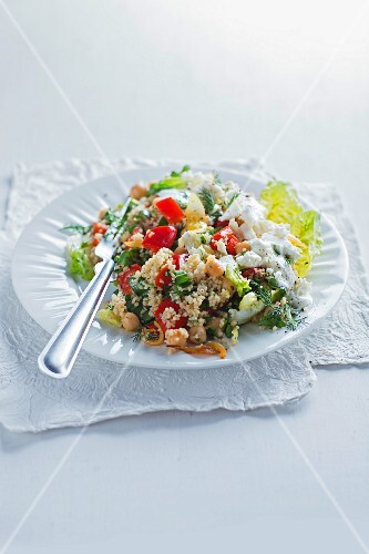 Chickpea salad with couscous, peppers and feta cheese