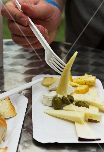A cheese platter with olives at a fast food stand