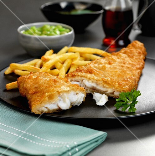 Battered haddock with fries and mushy peas