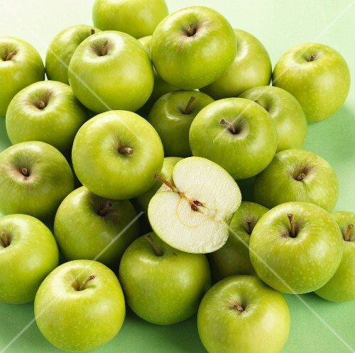 Granny Smith apples, one halved