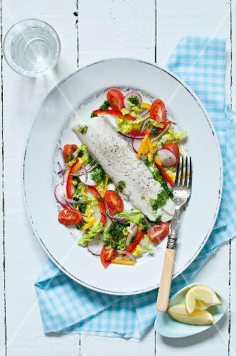 Steamed cod fillet with salad