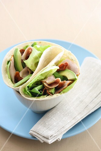 Wrap filled with chicken and avocado
