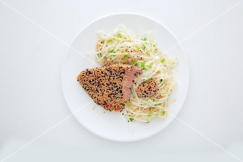 Fried tuna fish fillet with sesame seeds, black caraway seeds and glass noodles